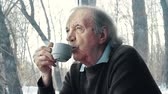 careca : Close up of senior man drinking tea with meditative expression