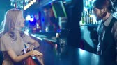 mutluluk : Close up of young girl ordering a drink at the club bar Stok Video
