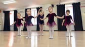rehearsal : Close up of five little girls standing in line and repeating ballet movements
