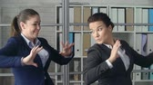 zaměstnanec : Close up of two business women performing jolly dance in the office