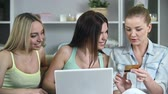 www : Close up of three beautiful ladies busy shopping online