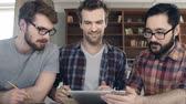 Öğrenciler : Close up of three funky guys networking with touchscreen device
