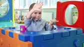 zábava : Little boy getting out of the toy house and waving