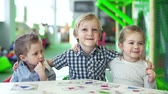 снимок : Close up of three little kids posing for a photo
