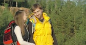 снимок : Side view of couple hiking in the countryside stopping to take a selfie and then continuing their trip
