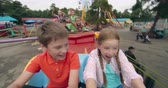 dzieci : Cheerful kids raising their arms during roller coaster ride