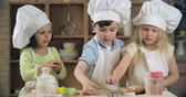 dough : Group of preschoolers decorating cookies with sprinkles