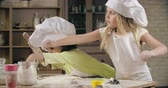 farinha : Two lovely little girls baking together Stock Footage