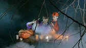 assustador : Evil kids conjuring over boiling cauldron on Halloween