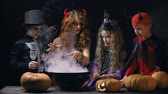 dia das bruxas : Devil woman teaching little evil characters to cook magic potion