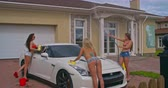 sedutor : Playful sexy girls enjoying a car wash in front yard