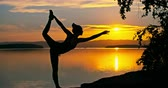 joga : Silhouette of woman practicing lord of dance yoga pose at sunset in nature