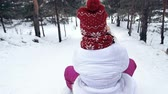 jogos : Rear view of little girls sledging downhill in slow motion