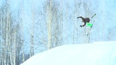 назад : Mountain skier doing a backwards flip in slow motion