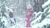 śnieżka : Playful kids throwing snowballs towards the camera in winter forest Wideo