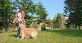 подросток : Teenager playing with his adorable dog in park