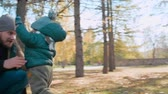 ходить : Cute little kid running from his mom to dad in the park