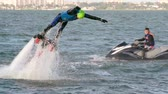 транспорт : Man jumping out of the water on flyboard attached to wavejammer