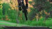 sujeira : Mountain bike rider jumping downhill in slow motion