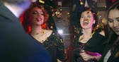 disko : Girls are dancing in cloud of gold confetti