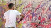 multicolorido : Rear view of an artist creating an abstract wall painting