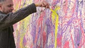 multicolorido : Painter decorating a wall with colorful acrylic paints Stock Footage