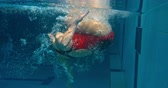 стена : Underwater view of woman swimming front crawl and doing flip turn in the pool Стоковые видеозаписи