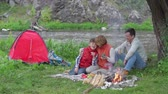 namiot : Mother, father and their son enjoying their camping weekend Wideo
