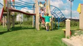 красочный : Rear view of little girl and two boys running to playground and going upstairs
