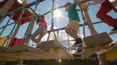 baixo ângulo vista : Low angle view of kids walking on playset in slow motion
