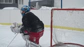 сеть : Ice hockey goaltender falling while catching a puck and making a save in slow motion Стоковые видеозаписи