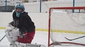 captura : Hockey goaltender preventing the opposing team from scoring by catching a puck in slow motion Stock Footage