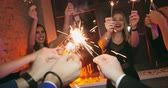fajerwerki : Group of men and woman dancing with sparklers at the Christmas party Wideo