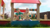 красочный : Zoom in of boy and girl counting colorful abacus disks on playground