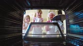 dzieci : View from the oven of two little sisters opening the door and their dad placing pizza inside for baking