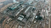 metalurgia : Aerial view of large metallurgical plant consisting of various industrial buildings and constructions with smoking chimneys polluting air
