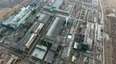 metalurgia : Aerial view of large industrial plantconsisting of various buildings and constructions with smoking chimneys polluting air