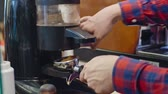 боб : Closeup of barista grinding coffee beans in dispenserand pouring freshly ground coffee into portafilter, slow motion shot Стоковые видеозаписи