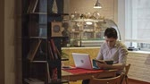 café expresso : Young Asian small business owner sitting at table in his cafe