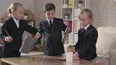 organizador : Two boys and cute girl in business suits working in the office together