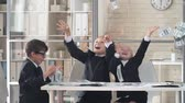 благополучия : Little girl and two boys in business suit tossing money and laughing in the office