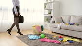 staff : attractive young female office manager finished work back to home finding mess living room feeling angry and looking at toys feeling incredible. Stock Footage