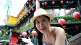 casa de campo : charming travel Asian girl like visiting famous landmark of Taipei Taiwan and using live video inviting her friends to come and have fun.
