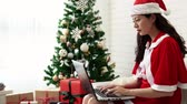 esperança : Asian Santa mother using computer pc to writing reply email to kids from all over of the world.
