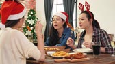 jantar : Young asia people gather together for enjoying Christmas dinner.