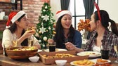 fast food : asia girl friends celebrating Christmas or New Year eve. Party table with food pizza. Stock Footage