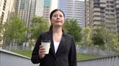 advogado : asian business woman walking drinking coffee. Lawyer professional or similar walking outdoors happy holding disposable paper cup. Stock Footage