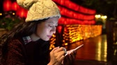 illumination : young woman using smartphone texting and illumination and lantern light on the background at evening. Stock Footage