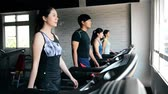 ginásio : Four people walking on the treadmill. They just finished the fierce exercise. Vídeos