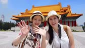 pontos : Asian traveler introducing Taiwan famous landmark Longshan Temple to her fans and friends on the social network through the internet.